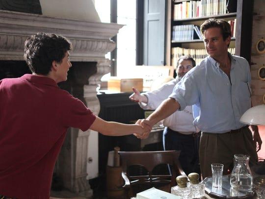 Elio (Timothée Chalamet, left) meets Oliver (Armie