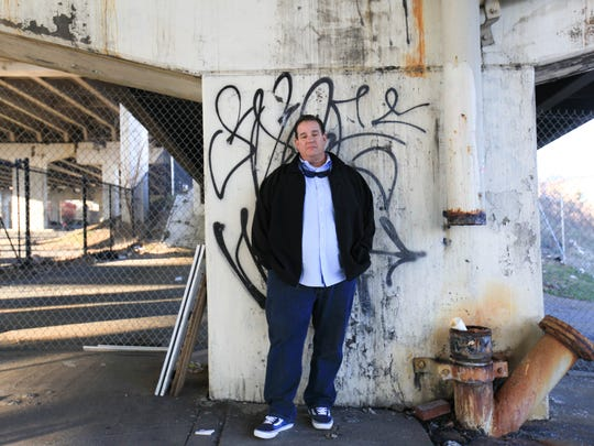 Anthony Santoro, former president of the Wilmington Skate Project, stands on the ground of a proposed skate park under I-95 that has been in the planning stages for more than 15 years.