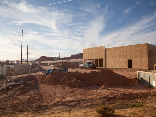 Construction crews work on the new Taco Bell on Red Cliffs Drive Friday, Dec. 29, 2017.