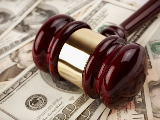 Paper money and a gavel from an auction  #filephoto