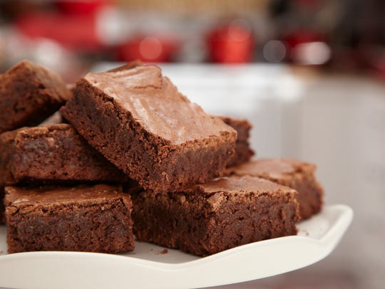 A batch of chocolate brownies on a plate.