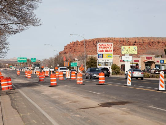 Crews continue expansion work on Bluff Street Thursday,