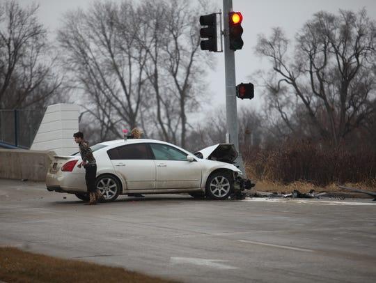A man driving a sedan struck an inmate transport wagon,