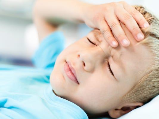 Little boy with headache