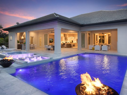 The Matera II features a pool with a fire pit.