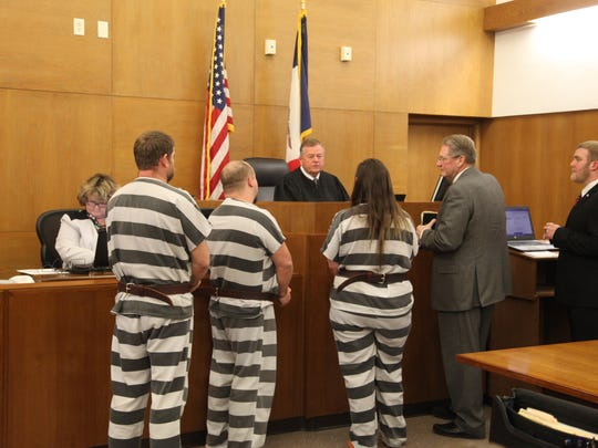 Judge James Heckerman speaks to defendants Ryan Belt, left, Tyler Palmer, center, and Kayla Stevenson during their sentencing hearing in Mills County District Court Monday. With them is defense lawyer Michael Murphy.