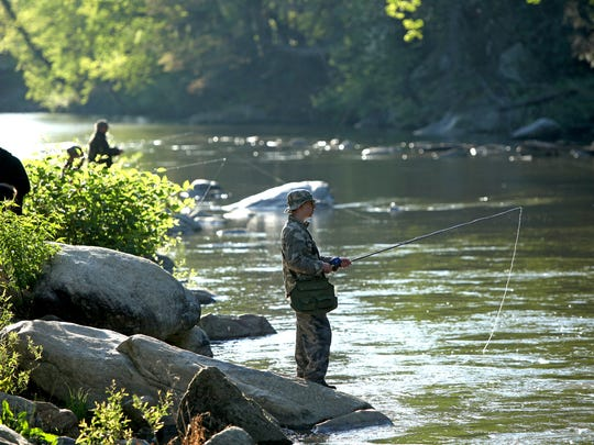 Fishermen line the Rocky Broad River in Bat Cave on a past opening day of hatchery-supported trout water fishing. The N.C. Wildlife Resources Commission will close 1,000 miles of hatchery-supported trout waters in WNC starting March 1 to stock them for opening day.
