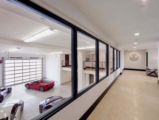 Inside a villa at Thermal Club, hallway windows overlook an expansive garage.