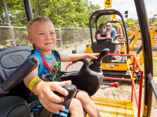 Kids are in the driver's seat of real modified construction equipment at Diggerland USA.