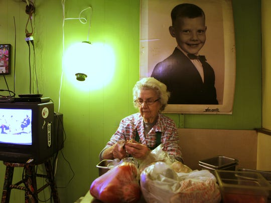 Maynie Tucker, when she was 90 in 2011, cutting mushrooms on a Saturday morning at Tucker's Restaurant.