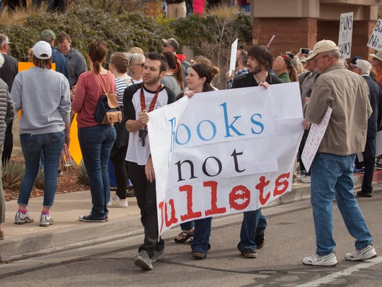 Members of the St. George community, led by Dixie State University students, participate in the March For Our Lives demonstration Saturday, March 24, 2018.