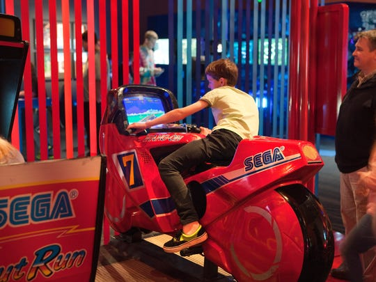 A guest enjoys a motorcycle video game at the Franklin