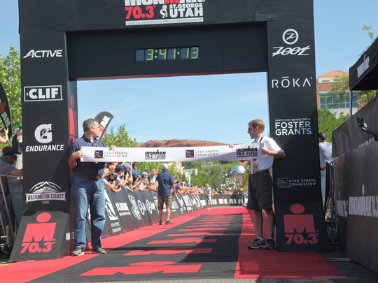 The IRONMAN 70.3 St. George finish line, where participants with prosthetics prove they're more than their disability.