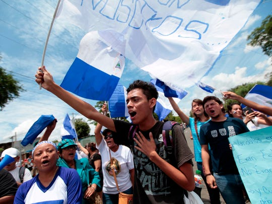 Anti-government demonstrators shout slogans in the