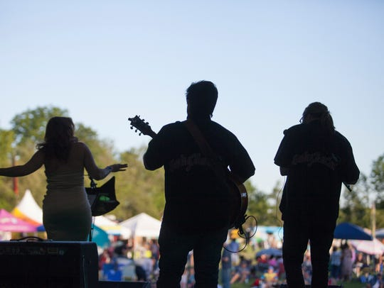 Musicians perform for a festival crowd at Appel Farm