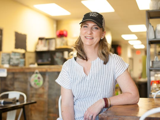 Laura Gossett, owner of Tasty Table Catering, draws