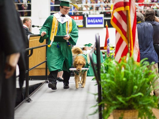 Northwest High School made a special graduation gown for Andrew Oglesby's service dog, Thor. They also presented him a diploma, which he proudly carried off the stage.