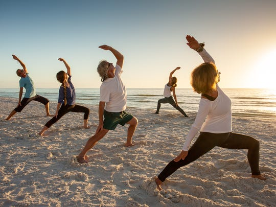 File: Global Wellness Day at JW Marriott Marco Island Beach Resort included classes in beach yoga, meditation and paddleboard yoga.