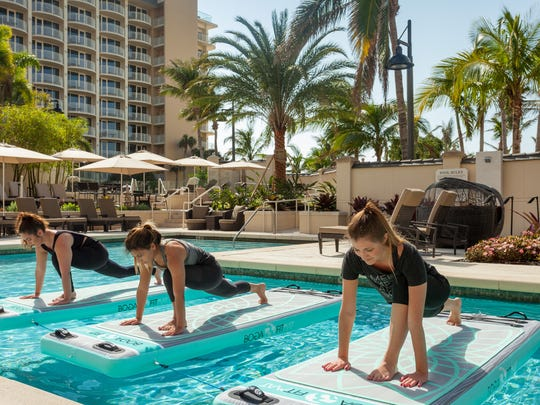 On Global Wellness Day the JW Marriott Marco Island Beach Resort offers classes in beach yoga, meditation and paddleboard yoga.