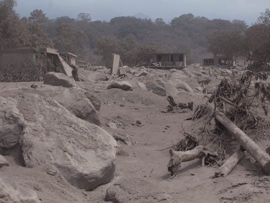 The village of San Miguel Los Lotes lies destroyed