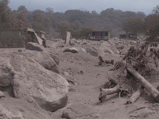The village of San Miguel Los Lotes lies destroyed and covered in volcanic ash spewed by the Volcan de Fuego, or Volcano of Fire in Escuintla, Guatemala, Tuesday, June 5, 2018. People of the villages skirting Guatemala's Volcano of Fire began mourning the few dead who could be identified after an eruption killed dozens by engulfing them in floods of searing ash and mud.