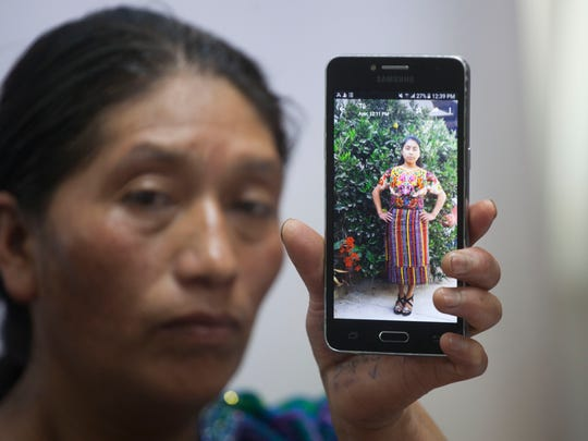 Dominga Vicente shows a photo of her niece, Claudia Patricia Gomez Gonzalez during a press conference at the National Migrants Commission headquarters in Guatemala City, Friday, May 25, 2018.