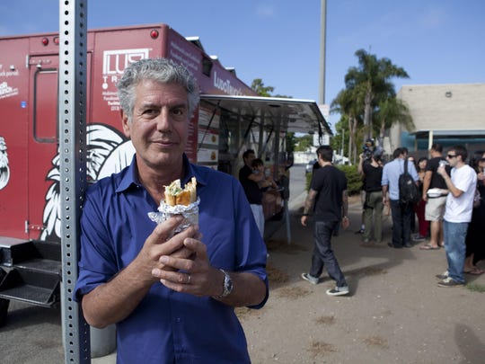 "Gilles Mingasson for The Travel Channel Anthony Bourdain tries the fried chicken at Ludo Truck?s Guerilla Chicken. He was filming an episode of his former TV show, ""The Layover,""  a project he said was ""utter, f--king misery."