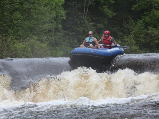 Rafters go over Sullivan Falls on the Wolf River in