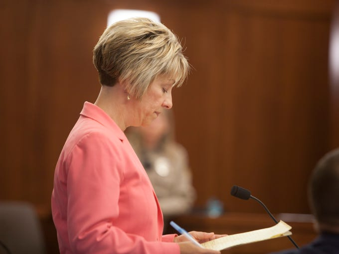Deputy County Attorney Angela Adams questions witnesses