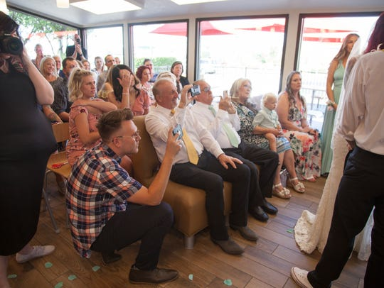 Family and friends attend the wedding for Abram and Jessica Thompson at the St. George Boulevard Wendy's Restaurant Friday, June 22, 2018.