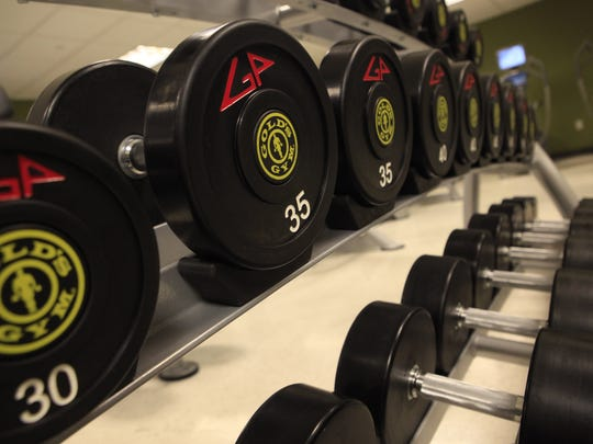 Dumbells are arrayed on a rack at Gold's Gym in Milwaukee.