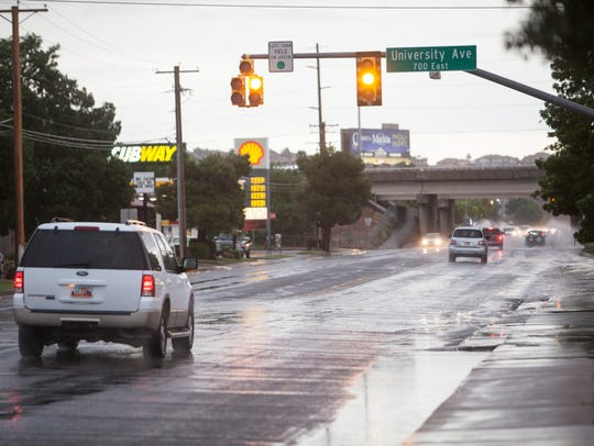 St. George drivers navigate through the rain on 700 South Thursday, July 12, 2018.