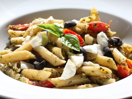 Penne with Pesto, Tomatoes, and Olives.