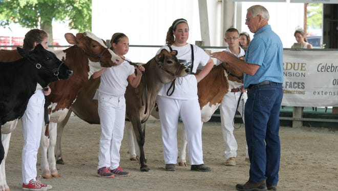 Dairy Show Judge Terry Price addresses the Intermediate Showmanship class at this year's Wayne County 4-H Fair in Richmond.