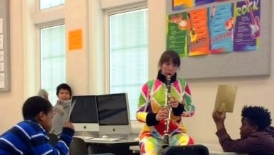 """A class of second graders at Pleasant Hill Academy enjoys """"Pierrot in Poetry"""" with Trina Carter, a member of concert:nova's """"Next-Gen"""" ensemble."""