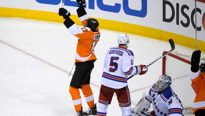 Philadelphia Flyers right wing Wayne Simmonds (17) celebrates his third goal of the game against New York Rangers goalie Henrik Lundqvist (30) and defenseman Dan Girardi (5) during the second period in game six.