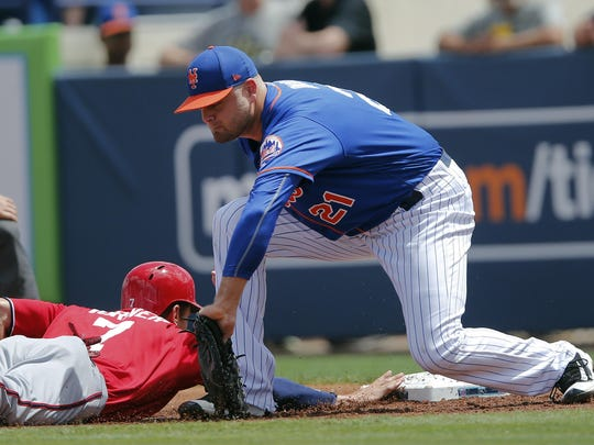Washington Nationals' Trea Turner (7) dives back safely to first base as New York Mets first baseman Lucas Duda (21) applies the late tag in the first inning of a spring training baseball game Monday, March 27, 2017, in Port St. Lucie, Fla. (AP Photo/John Bazemore)