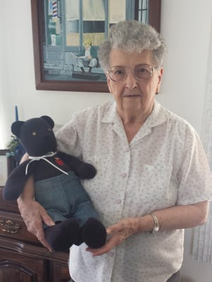 Bobbie Zolbe, 87, stands with one of 400 bears she has sewn for SpiriTrust Lutheran Home Care & Hospice's program to comfort bereaved families.