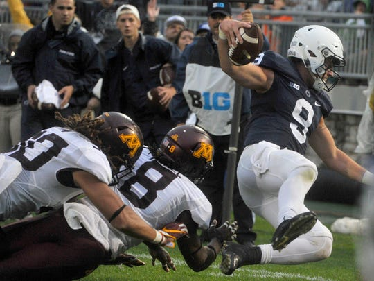 Penn State QB Trace McSorley dives toward the end zone during his second half touchdown that helped put PSU over Minnesota 29-26 at State College on Saturday, Oct. 1. 2016