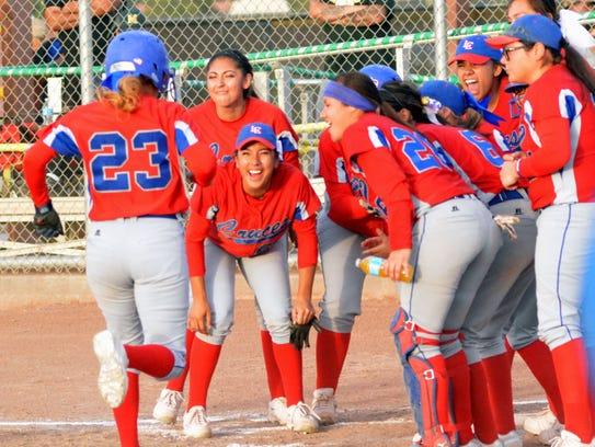 Las Cruces teammates await Mariah Hernandez at home