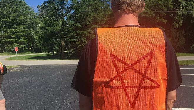 A member of The Satanic Temple Indiana cleans a part of U.S. 421 during the organizations Adopt-A-Highway effort