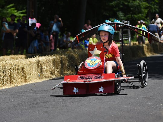 Second annual Downhill Derby in Rutherford, NJ on Saturday June 16, 2018. Olivia Mendelsohn, nine years old, heads downhill in her Wonderwoman themed car.