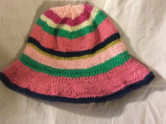 I am tickled pink by this predominantly pink striped hat.