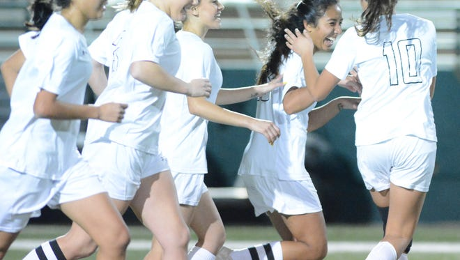 Abilene High players celebrate with Gabby Valero, second from the right, after the junior's second-half goal during the Lady Eagles' 2-0 win over crosstown rival Cooper on Friday at Shotwell Stadium. The Lady Eagles open their 2019 season Jan. 3 in the Embree Duck Creek Tournament.