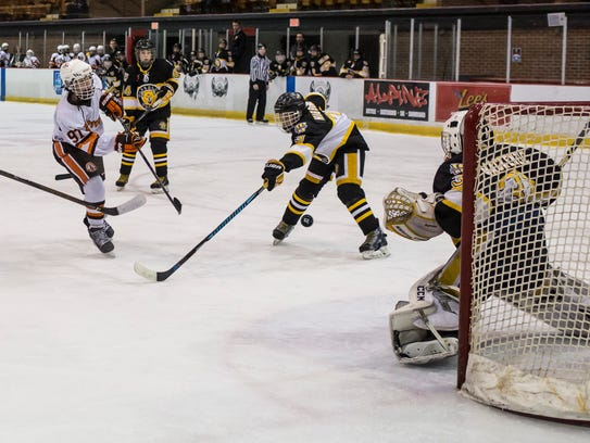 Detroit Compuware's Gavin Hayes scores on the Waterloo