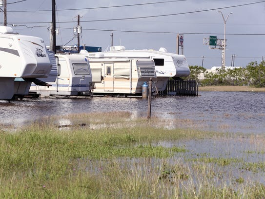 High tides caused parts of North Beach to flood Thursday,