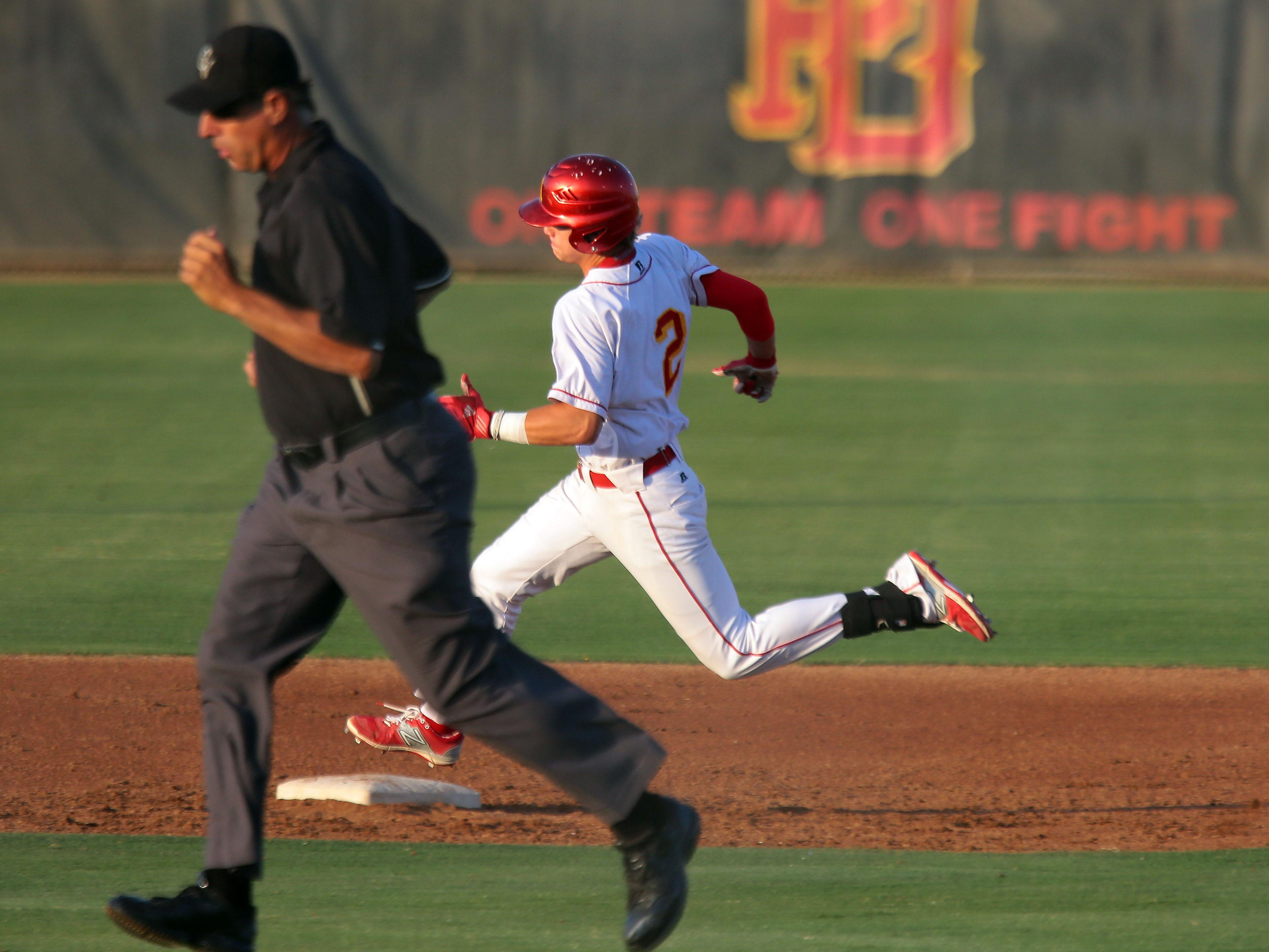 Palm Desert's Travis Moniot runs around the bases after a triple against Indio.