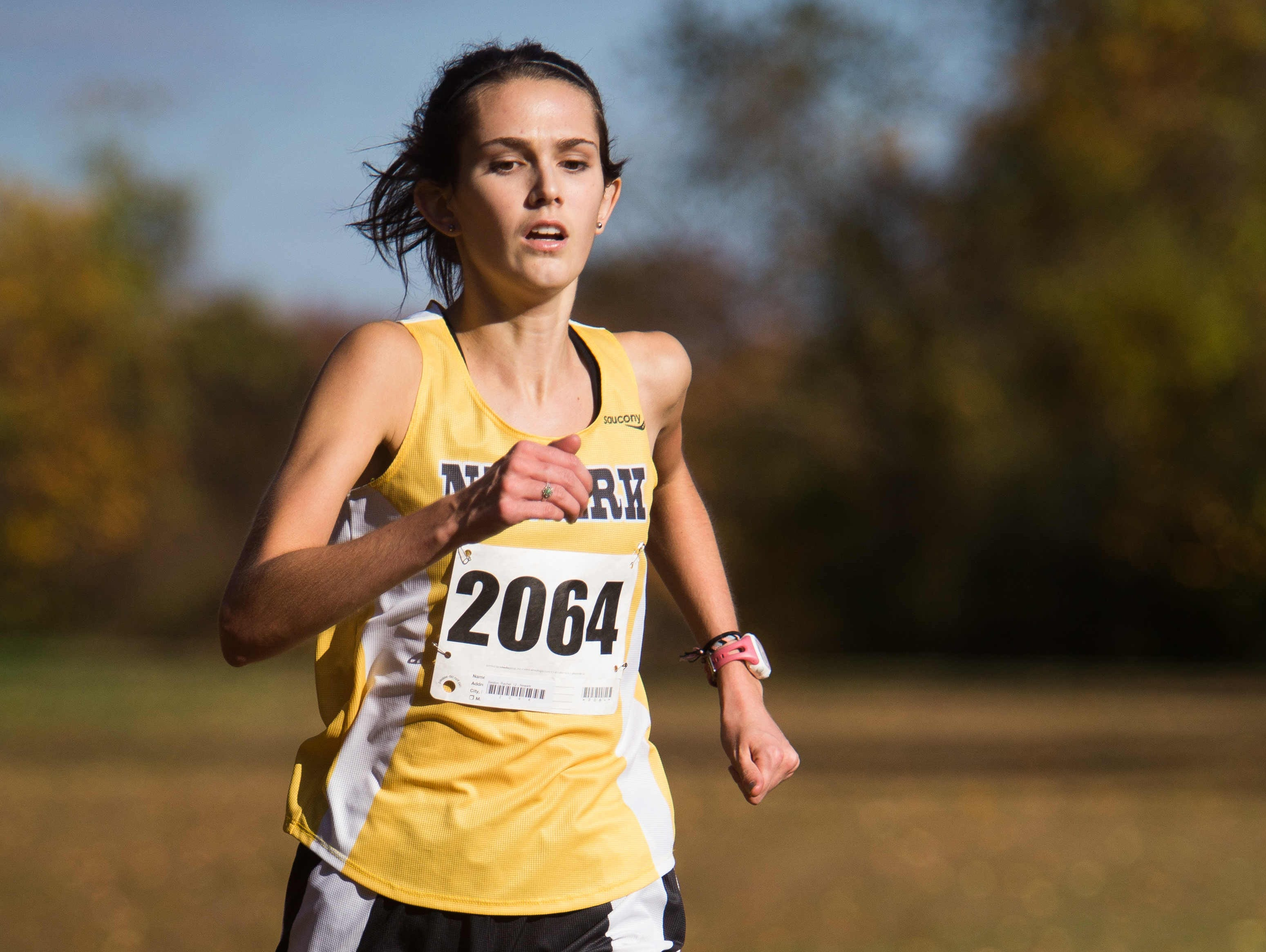 Newark senior Rachel Beston crosses the finish line in first place with a time of 18:26 in the Blue Hen Conference Championship at White Clay Creek State Park in Newark.