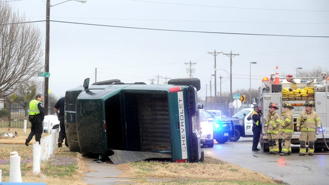 A pickup truck overturned on the part of Buffalo Gap Road where it tunes into Sayles Boulevard as the drizzle continued around 3 p.m.