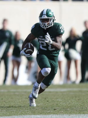 Michigan State running back Madre London runs the ball during the spring game at Spartan Stadium, Saturday, April 1, 2017.